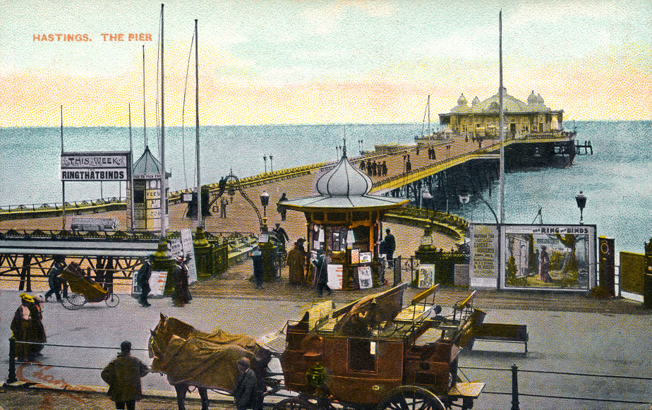Hand-tinted postcard of the Pier with coach and horses
