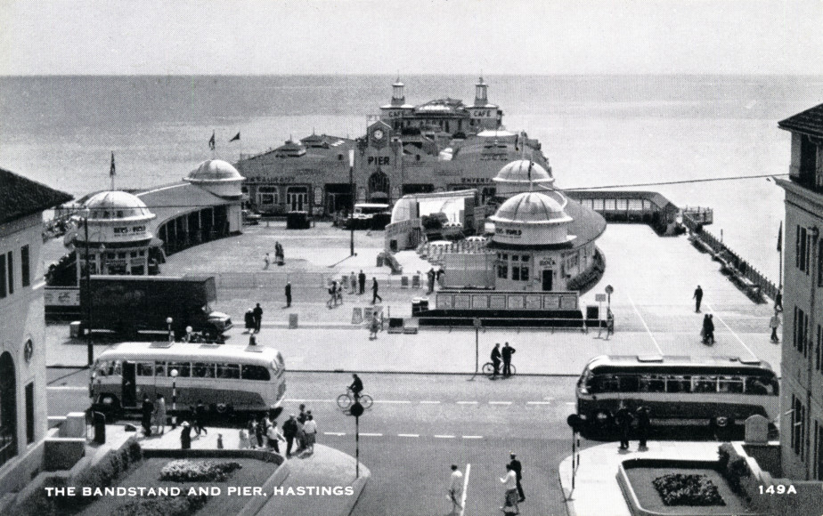 Black and white postcard of bandstand and Pier