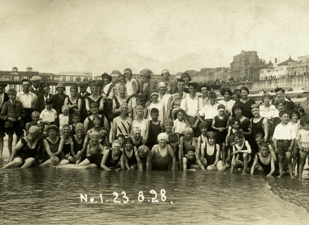 A group of bathers in front of the Pier, 1928