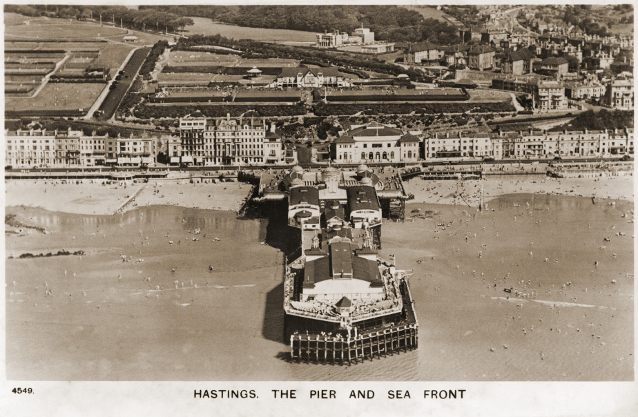 1930-1960s postcard aerial view of Hastings pier and seafront