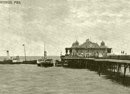 Hand-tinted post card of paddlesteamers at Hastings Pier