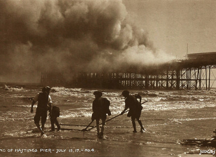 Boys beachcombing after Hastings Pier fire, 1917