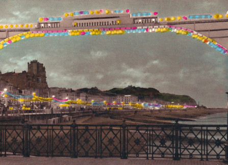 Illuminated promenade from Hastings Pier
