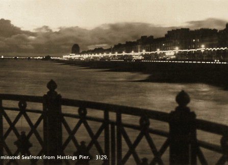 Illuminated seafront from Hastings Pier