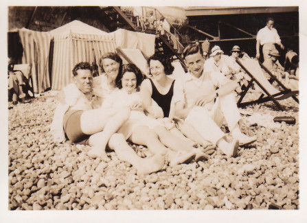 Family photograph on beach next to the Pier, 1930s