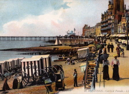 Coloured postcard of beach with bathing machines