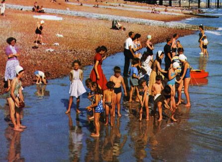 Children paddling next to Hastings Pier, 1950s