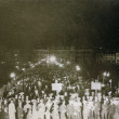 A crowd on the Pier at night