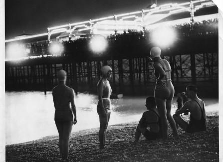 Floodlit bathers on the beach, 1930s
