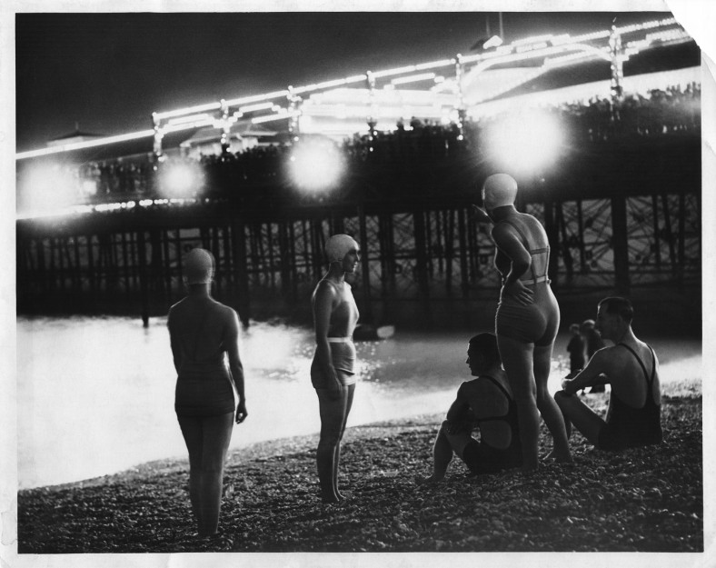 Floodlit bathers on the beach, 1930s | East Sussex County Council Library & Information Service