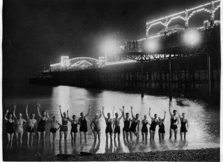 Night swimmers next to Hastings Pier, 1935