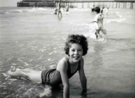 Jill Bradley enjoying Hastings beach, 1950s