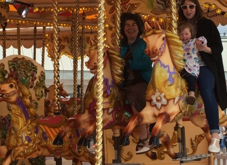 A traditional carousel on the opening day on the Pier with Bea Rapley and family