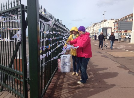 Volunteers putting up the bunting created by local children.