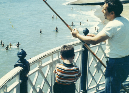 Father and son fishing off the Pier