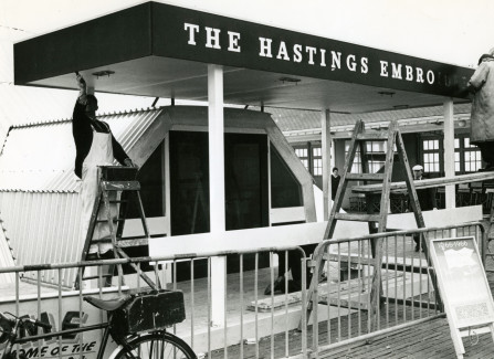 Men working on the signage for the Triodome on Hastings Pier