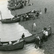 A fishing competition with boats landing on Hastings beach
