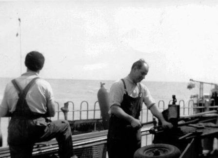 Engineers working on ironwork to repair the Pier, 1950s
