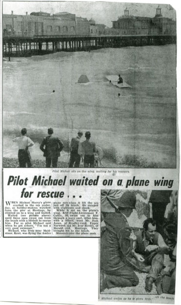 Pilot Michael Macey waiting for rescue on the wing of his downed plane.