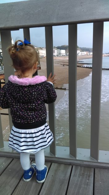 Toddler looking at the sea