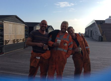 Michael Holmes, Stephen Phillips, Brian Phillips taking a break from painting on the pier