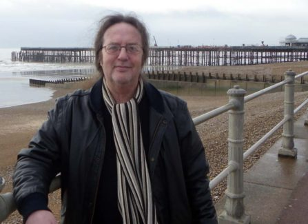 Colin Bell in front of Pier reconstruction